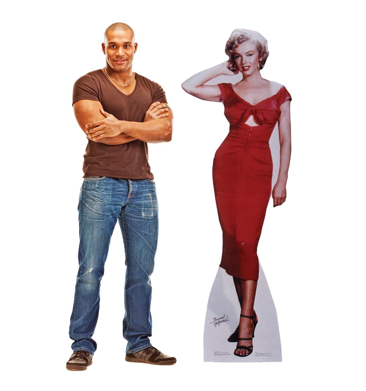 Life-size cardboard standee of Marilyn Monroe Niagara with model.