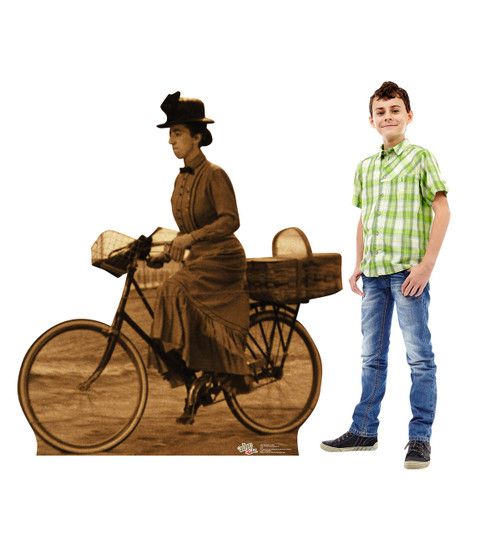 Life-size Miss Gulch on Bike - Wizard of Oz Cardboard Standup next to child