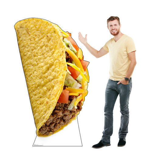 Life-size cardboard standee of a Taco with model.