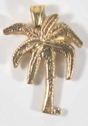 The palm tree pendant is 14 K yellow gold and is hand crafted in Portland, Maine.  The pendant weighs 6.8 grams and measures 1.5 x 1.2 x .25 inches and has a textured pattern on the front.  The pendant has a 2 mm. round brilliant cut diamond with a color of J and a clarity of I1.  The pendant is solid.