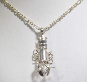 The silver Maine lobster pendant is hand crated in Portland, Maine.  The pendant is a lobster measuring 1.5 x .75 x .4 inches and weighs 4.3 grams.  The chain is sold separately.The silver Maine lobster pendant is hand crated in Portland, Maine.  The pendant is a lobster measuirng 1.5 x .75 x .4 inches and weighs 4.3 grams.  The chain is sold separately.