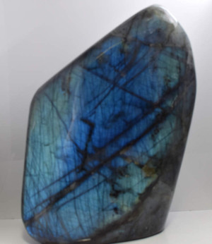 The large labradorite polished specimen is from Madagascar.  This piece is an exquisite one.  It measures 11 x 7.5 x 4 inches and has exceptional blue color on both sides.  All sides are polished and glisten.