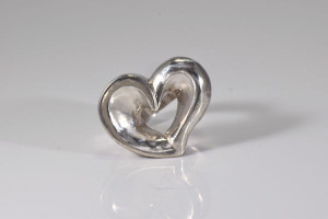 The sterling silver large open heart ring is hand crafted in Portland, Maine.  The ring is a heavy and solid open off set heart ring weighing 30 grams.  The ring is a size 7.75 and can be sized upon request.