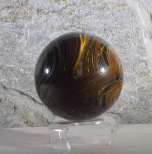 The  tiger iron sphere is a great specimen for your collection.  This sphere is a 4 inch with a great pattern on the piece. The tiger iron the measures 4 inches in diameter.ere