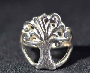 The spiral tree of life ring is made of sterling silver and is handcrafted.  The ring is inspired by the earth element.  The ring is a size 9 and can be sized upon request.  It can also be made in brass or 14 k yellow gold. The ring weighs 7.5 grams and measures 1 inch wide and the shank is a double wire that is 3.75 mm. in width.