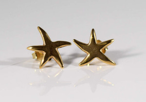 The 14 K yellow gold stud earrings weigh 1.6 grams.  The earrings measure 12 mm. in diameter.  The earrings are polished starfish earrings.