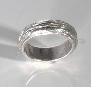 The sterling silver Maine blue jays birds nest ring is hand crafted in Portland, Maine.  This band is a 6.5 mm. version inspired by the blue jays nest.  This ring is a size 6.5 and weighs 8.1 grams.  the ring can be sized upon request.