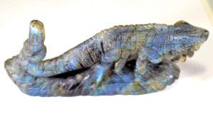 The labradorite chameleon is exquisitely carved  in detail.  The carving is in labradorite from Madagascar and has a frosted finish.  The figurine is 289.1 grams and measures 6 x 2 x 1.5 inches.  There is a great blue and yellow color to this little creature.