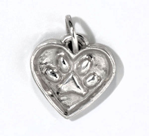 The sterling silver pet paw pendant is handcrafted and measures 27 mm. x 31 mm. x 3 mm.  The pendant weighs 8.9 grams and can be engraved upon request.  We donate 10 % of the profits to the Animal Refuge League. This pendant was created to remember a very special pet that we no longer have.  This piece was made in Portland, Maine.
