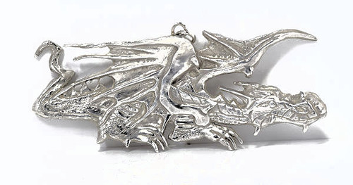 The sterling silver horizontal dragon pendant is very unique hand crafted piece . The pendant is a solid piece that weighs 31.2 grams. The pendant is 2 dimensional and measures 3.5 x 1.5 x.25 inches. The dragon was crafted in Portland, Maine.