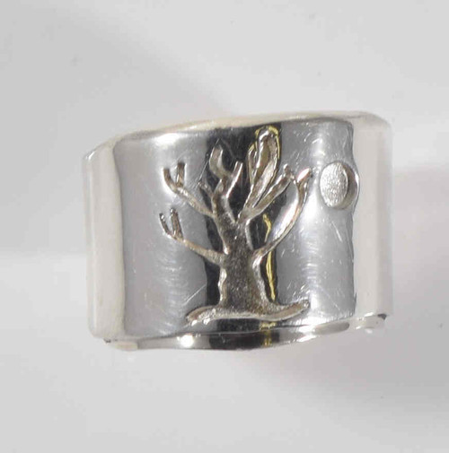The ring is a sterling silver tree of life ring with a moon.  The ring is a hand crafted  in Portland, Maine and  has  a carved tree of life ring with a moon off to the side.  The ring weighs 10.4 grams and measures 1.8 mm. thick.  The top of the ring is 15.4 mm. and tapers to 6.5 mm. at the base of the shank. The ring is a 6.75 and can be sized upon request.