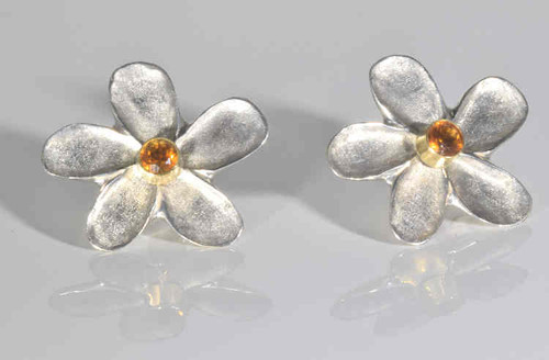 The citrine flower silver earrings are hand crafted in Portland, Maine.  The citrine is a faceted 5 mm. round.  The stone is set in a sterling silver flower style .  The earrings are 26 mm. in diameter and weigh 12 .4 grams