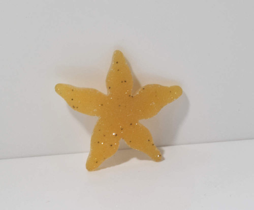 The natural druzy starfish is golden with slight black spots.  The hand carved starfish weighs 4.3 grams and measures 33 mm. x 36 mm. x 3.5 mm.