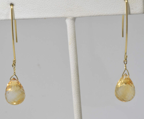 The citrine drops are hand crafted in Portland, Maine.  The citrine is a light faceted briolette pear shaped.  The briolette measures 11 mm. x 10 mm. and the drop wires are 14 k yellow gold.  The earrings weigh 3.8 grams and the briolettes weigh 13.68 carats.  The earrings are 2 inches in length.