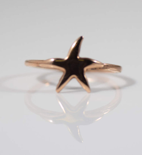 The 14 K rose gold starfish ring is hand crafted in Portland, Maine.The ring is a size 7 heavy.  The starfish measures 12 mm x 12 mm. and is a a 2 mm. shank that weighs 2.1 grams.