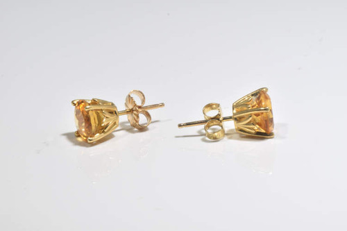 The citrine stud earrings are hand crafted in Portland, Maine.  The citrines are 7 mm. round faceted.  The earring are  14 k yellow gold, antique style heads.  The stones are 7 mm. rounds  and weigh 1.8 grams.  The citrines are medium in color.
