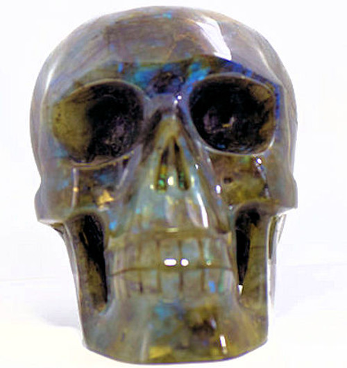 The labradorite skull is amazing. The carving is very detailed.  The skull measures 7 inches in length, 4.75 inches wide, and 5 inches high.  The skull has a very high polish on it.