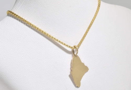 The 14 k yellow gold state of Maine charm is hand crafted in Portland, Maine.  The charm is a polished piece measuring 21 mm. x 11 mm. and weighs .9 grams.