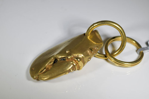The brass lobster claw key chain is handcrafted in Portland, Maine.  The lobster key chain weighs 76.3 grams and is solid.  The key chain fit great in the hand.  The length is 3.25 inches by 1.25 inches.  The thickness is .5 inches in the claw and the large jump ring is 1 inch.  The claw has a satin finish and the rings are polished.