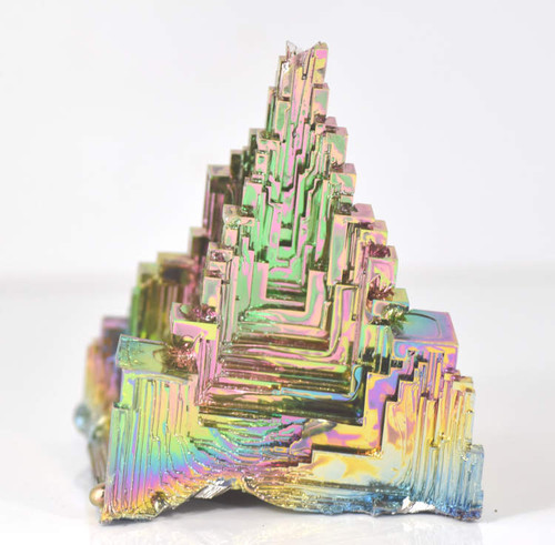 The bismuth pyramid is a futuristic shape. The piece is 3 x 3 x 2 inches. I have several different ones which all slightly different. It weighs 422.4 grams.