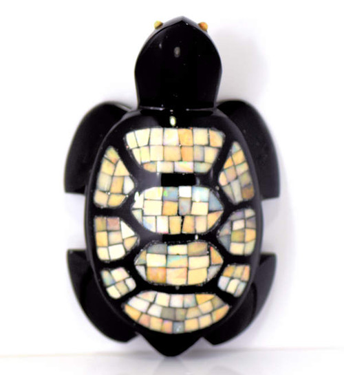 This opal and obsidian turtle is a lovely hand crafted piece from Mexico.  There is a high polished finish on the inlay sections of opal.  The turtle has small opal eyes and his back is sectioned with opal.  The turtle weighs 223 grams and measures 4 x 3 x 2.75 inches. He is truly a one of a kind.