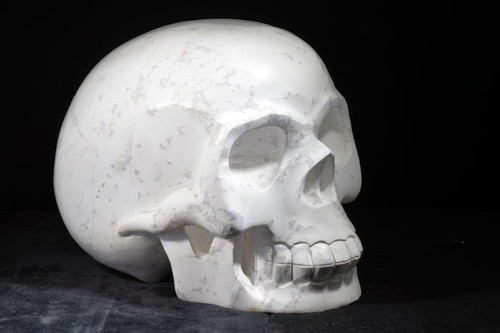 The carved howlite skull is life sized.  The skull measures 8 x 9 x 5.5 inches and has a nice polished finish.