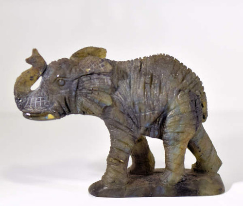The labradorite elephant is very detailed in every aspect. The carving is very proportioned.  The elephant weighs 224.8 grams and measures 4 x 3.5 x 1.5 inches and is from Madagascar.