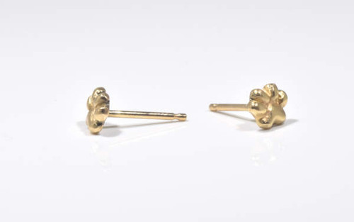 The tiny gold paw studs are hand crafted in Portland, Maine.  The paw is a 2 dimensional stud weighing 1.8 grams and measures 6.2 mm. x 8.2 mm. x 1 mm.  The paw is a special stud for us to remind us about four legged friends.  A portion of the profits will be donated to the Animal Refuge League of greater Portland, Maine.