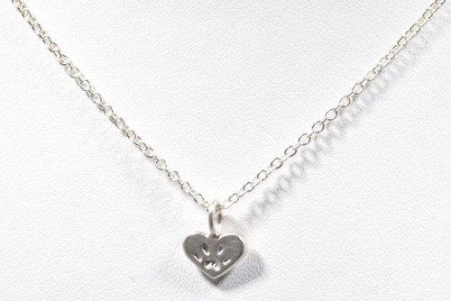 The sterling silver heart paw pendant is hand crafted in Portland, Maine.  this is part of the pawz collection , that a portion of the profits are donated to the Animal Refuge League of Portland, Maine.  The pendant is a heart measuring 7 mm. x 9 mm. and weighs .7 grams.  The pendant is sold separately from the chain, but a chain is avail able please inquire.  The chain depending on the length will be approximately $20.00.