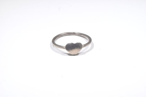 The tiny silver heart ring is hand crafted in Portland, Maine.  The ring is sterling silver and is a size 7.5.  the ring has a heart that measures 7 mm. x 9 mm. and the band is 2 mm., weighing 1.5 grams.