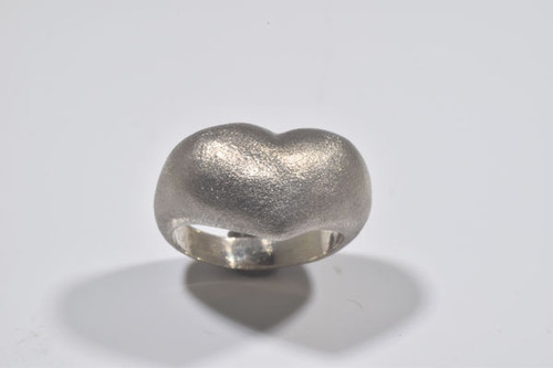 The sterling silver puffy heart ring is hand crafted in Portland, Maine.  The ring is a puffy heart with a brushed finish and the ring is a size 6.5.  the heart ring measures a 3 mm. shank and a puffy heart that is 18 mm. wide and weighs 7.2 grams.
