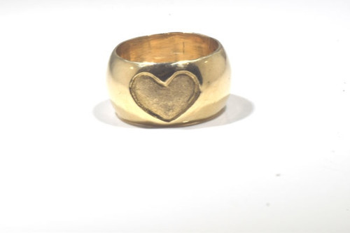 The old Carved Heart band is hand crafted in Portland, Maine.  The ring is 14 k yellow gold and is 10 mm. wide weighing 12.4 grams.  The heart is 11 mm. x 8 mm. and has a textured finish.  The band is half round.