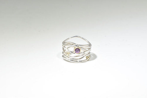 The pink sapphire and diamond wire ring is handcrafted in Portland, Maine. The ring is a sterling silver and 18 k yellow gold ring with a 4.5 mm. round pink sapphire.  there are two round brilliant cut diamonds measuring 1.8 mm.  the stones are set in 18 k yellow gold bezels.  The ring is a size 7 and weighs 4.7 grams.  The wire ring at its widest point is 15 mm.  September birthstone is a sapphire.