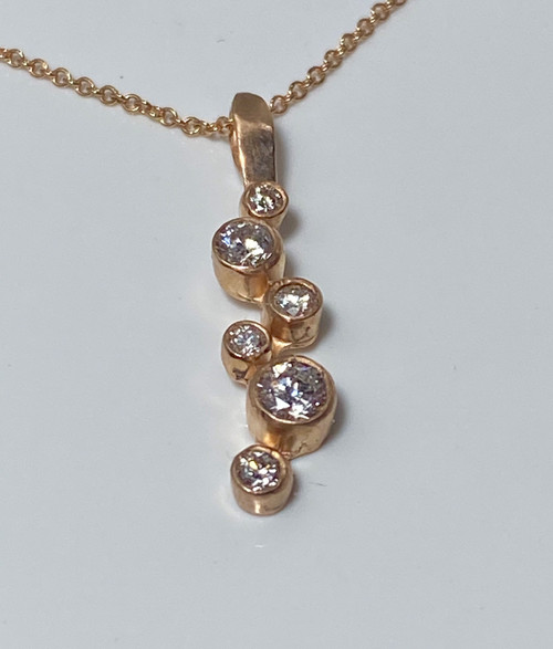 This is pendant is made in 14 K rose gold and has six diamonds and handcrafted in Portland, Maine