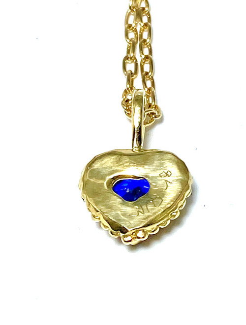 The sapphire heart sapphire pendant is handcrafted in Portland, Maine.  The sapphire is a blue Ceylon measures 7.3 mm. x 6.5 mm.  The pendant measures 18 mm. x 14 mm. x 6 mm. and weighs 3.7 grams.  The pendant is handcrafted in a beaded bezel in 18 K yellow gold. This pendant is on a 14 K yellow gold 18 inch open link paper chain weighing 5.0 grams and 1.6 mm. wide.  The pendant can be sold separately, please contact for pricing.  Sapphire is the September birthstone.