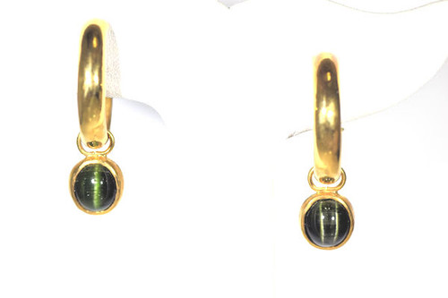 The cats eye tourmaline drops are hand crafted in Portland, Maine.  The drops are green tourmaline cats eye ovals.  The stones are 10 mm. x 9 mm. and are bezel set in 18 k yellow gold dangles.  The dangles are on a 18 k yellow gold 5 mm. half round custom hoop.  The hoop is a 1 inch outside diameter.  The earrings are .5 inches in length and weigh 14.8 grams.  The dangles come off of the hoops so the hoops can be worn separately.