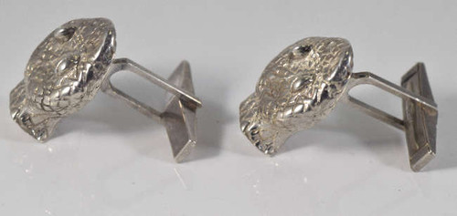 The snake cuff links are hand crafted in Portland, Maine in sterling silver.  The snake head is a two dimensional piece measuring 22 mm. x 26.5 mm. x 85 mm.  The cuff links weigh 30 grams and have a adjustable cuff link attachment.  Sterling Silver Snake Heads Made in USA