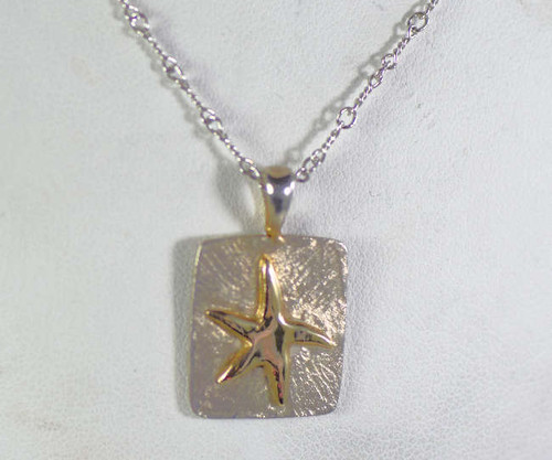 The gold and silver starfish pendant is hand crafted in Portland , Maine.  The pendant is a rectangular shape and measures 15.5 mm. x 17.5 mm. 2 mm.  and weighs 3.1 grams.  The base of the pendant is sterling silver and the starfish is 14 K yellow gold and it has a textured background and a polished starfish.