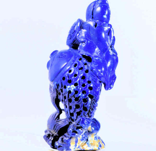 The lapis Carved fish is hand carved with great detail and is a one of a kind.  The lapis is very fine quality and is from Afganistan. The carving weighs 34.5 grams and measures 2.5 x 1.25 x 1 inches.
