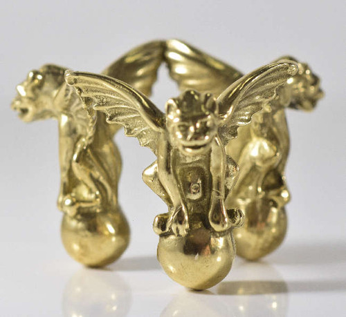 The golden gargoyle stand is a medium sphere stand.  There are three gargoyles connected at the wings forming a stand.  The stand is brass plated with gold and measures 1.2 x 1.5 x 175 inches, weighing 35.9 grams.  This is something that should be added to your sphere collection.