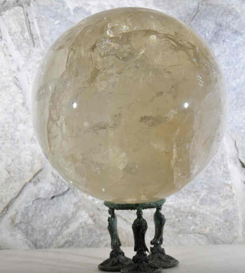 The quartz sphere is a natural quartz crystal ball.  It is 9 inches in diameter. This piece comes from Brazil