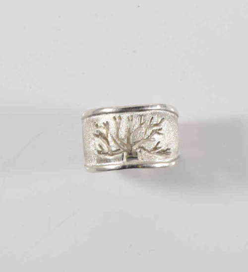 The sterling silver tree of life ring is beautifully handmade.  The tree is cut out in the center and  it measures 13 mm. x 7 mm. weighing 7.7 grams with a brushed and polished finish.  The ring is a size 6 and can be sized upon request.  This ring is also available in 14 k rose, 14 k yellow gold.