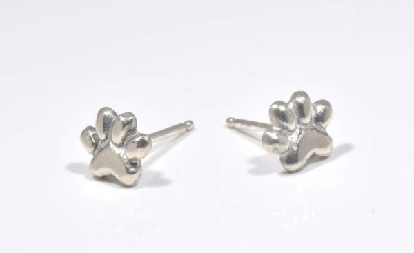 The sterling  silver small pet paw print is hand crafted in Portland, Maine.  The earrings are sterling silver and measure 6.6 mm. x 8 mm. and are solid.  The paws weigh 1.49 grams.  A portion of the profits will be donated to the Animal Refuge League of greater Portland, Maine.