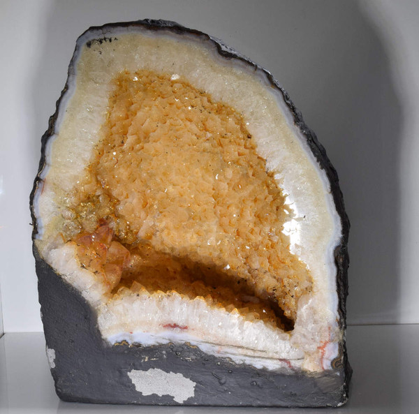 Citrine geode (small cathedral).  The citrine is a lighter yellow color.  The cathedral weighs approximately 8 pounds.  It measures 8 x 6.25 x 5.2 inches.