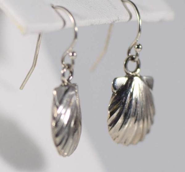 The sterling silver shell earrings are hand crafted in Portland, Maine.  The earrings are three dimensional shells on a french hook dangle.  The shells measure 1 1/8 x 1/2 inch and the over all earring length is 1 inch.  The earrings weigh 6.8 grams.