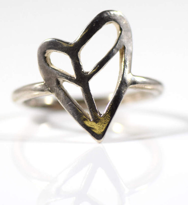 The sterling silver peace heart ring is hand crafted in Portland, Maine.  The ring is an off set heart open with a peace symbol on the inside measuring 3/4 x 9/16 and weighing 2.9 grams.  The ring is a size 8.