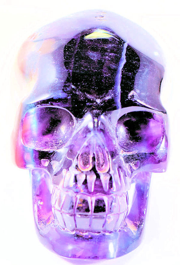 The purple flourite skull is uniquely carved.  The skull  is made from flourite that is from Hunan, China.  The skull is a dark purple and reflects purple in the light.  the skull measures 2.75 x 4 x 2.5 inches and weighs 639 grams.