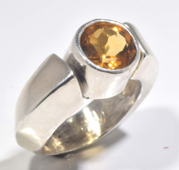 The contemporary citrine chunky ring is hand rafted in Portland, Maine.  The citrine is a 9 mm. round set in a bezel with a knife edge and square ring.  the ring is sterling silver and weighs 11.6 grams.  The ring is a size 6.5.  Citrine is the November birthstone.