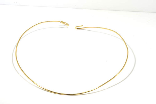 The 14 K yellow gold collar is hand crafted in Portland, Maine.  This collar is shown on the golden beryl and diamond pendant.  The collar is 16 inches and weighs 9.6 grams.  the collar is solid and is 2 mm. diameter.