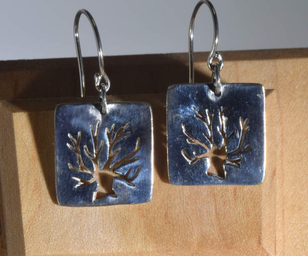 The sterling silver square tree of life earrings are hand crafted in Portland, Maine.  The earrings are cut out tree of life measuring 30 mm. x 16 mm. and weigh 4.0 grams.